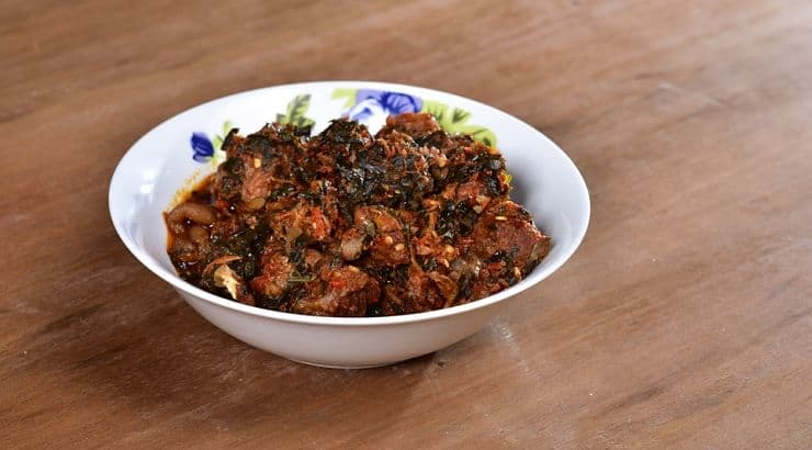 Efo Riro is a Nigerian dish commonly served with pounded yam.