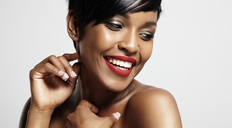 An African American Woman With Short Hair And Red Lipstick