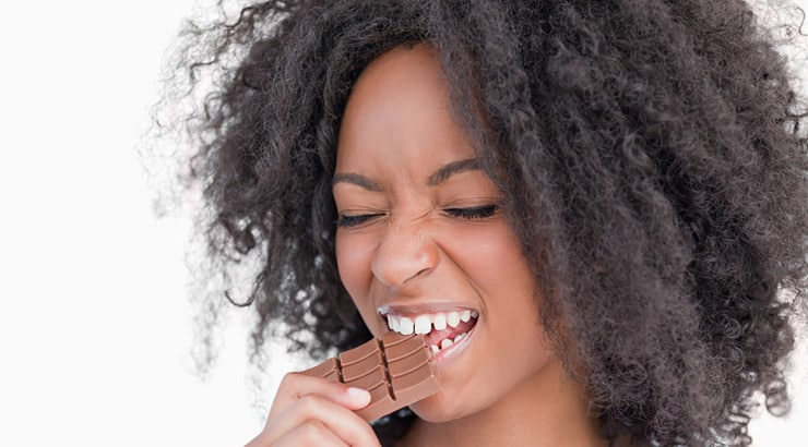 Black Woman Eating Chocolate