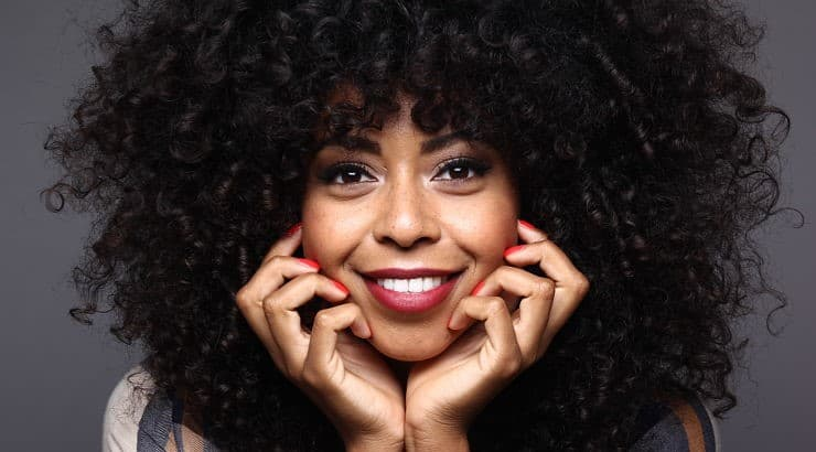 Flat irons can help women with curly hair achieve flawless, sleek, and shiny straight hair.