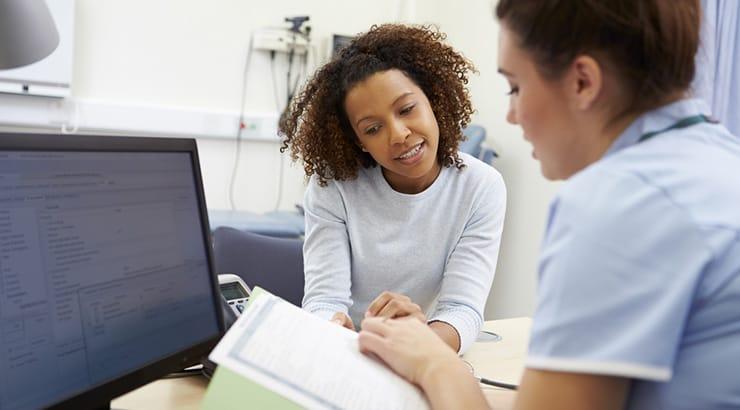 Black Woman With A Nurse