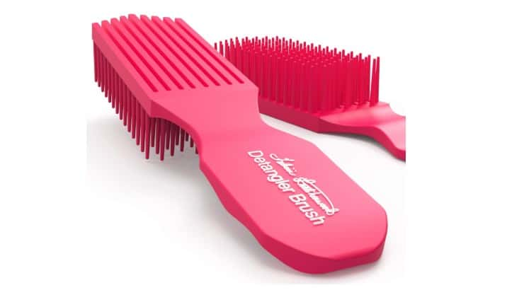 Felicia Underwood's detangling brush comes with a wide handle and flexible bristles to help diminish discomfort in the hand and hair.