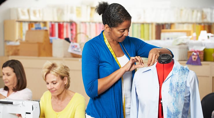 Black-Woman-Sewing-Shirt-On-Mannequin
