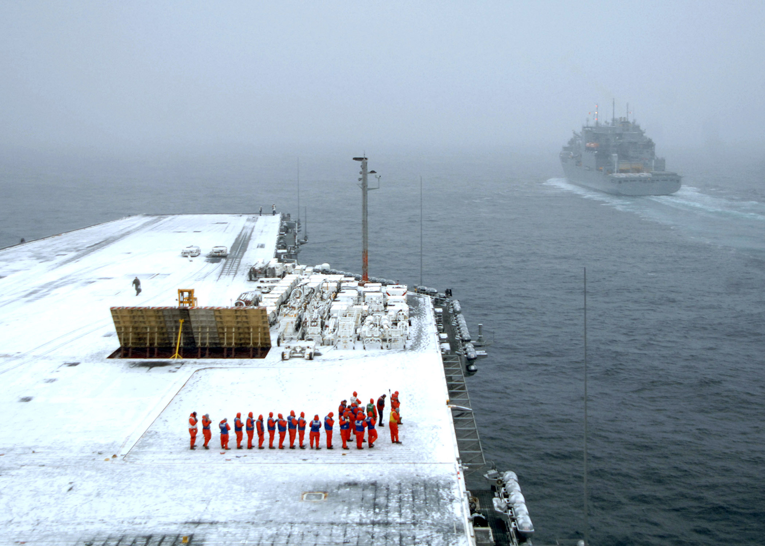 Sailors Make Snow Angels On Deck Of Supercarrier During Storm - The