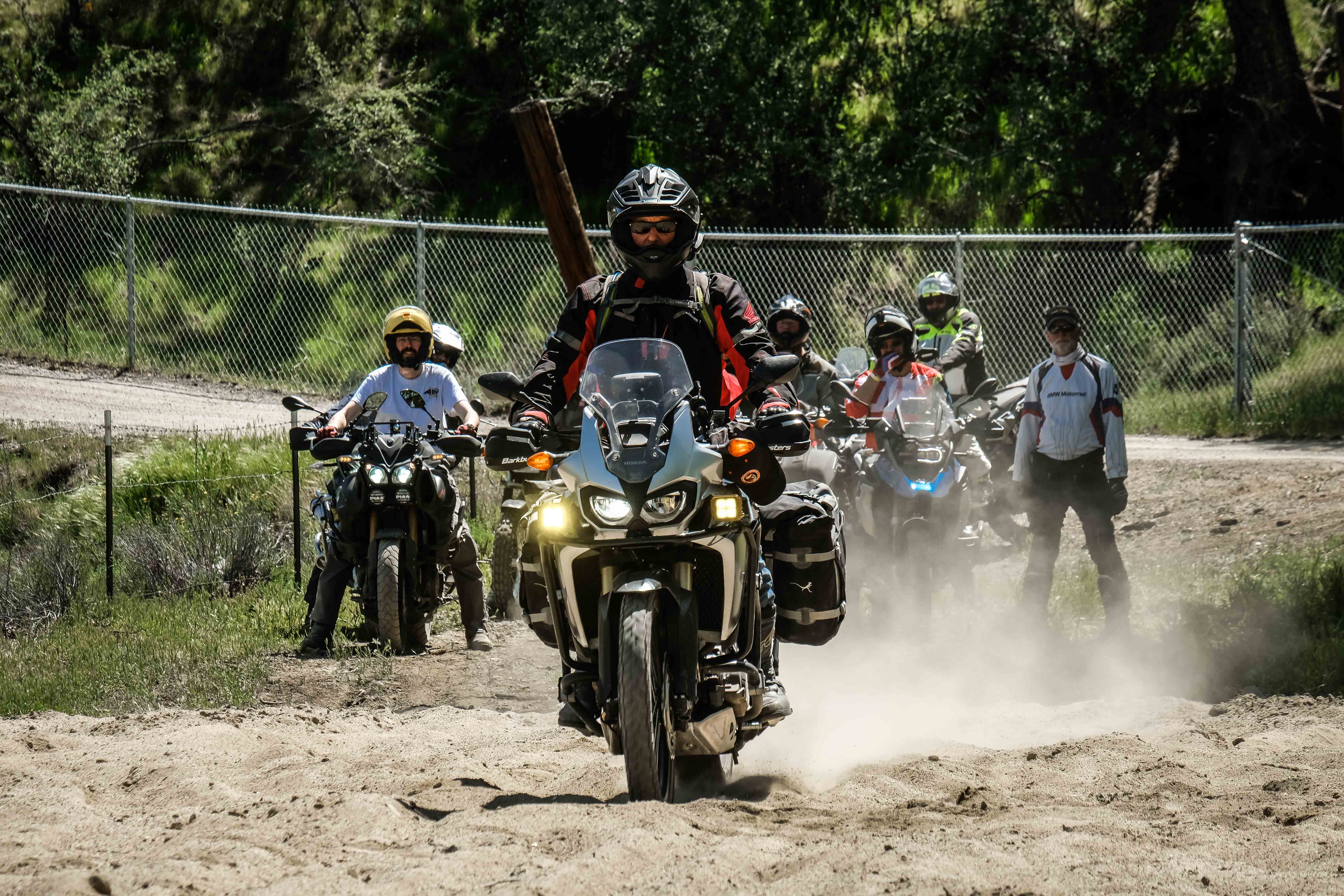 A student takes their Honda Africa Twin through the sand wash.