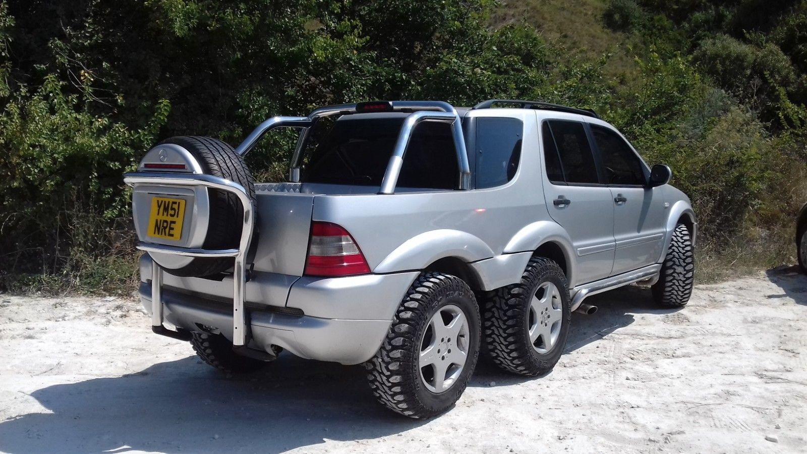 You Can Buy This Hideous But Cool Six Wheeled Mercedes Benz Ml On Ebay Right Now The Drive