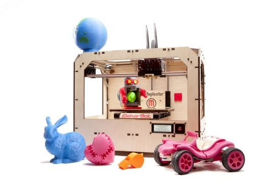 "Figure 1.2: The ""Replicator"", an inexpensive 3D printer that prints object in colours."
