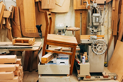 A handmade chair being produced inside the studio.