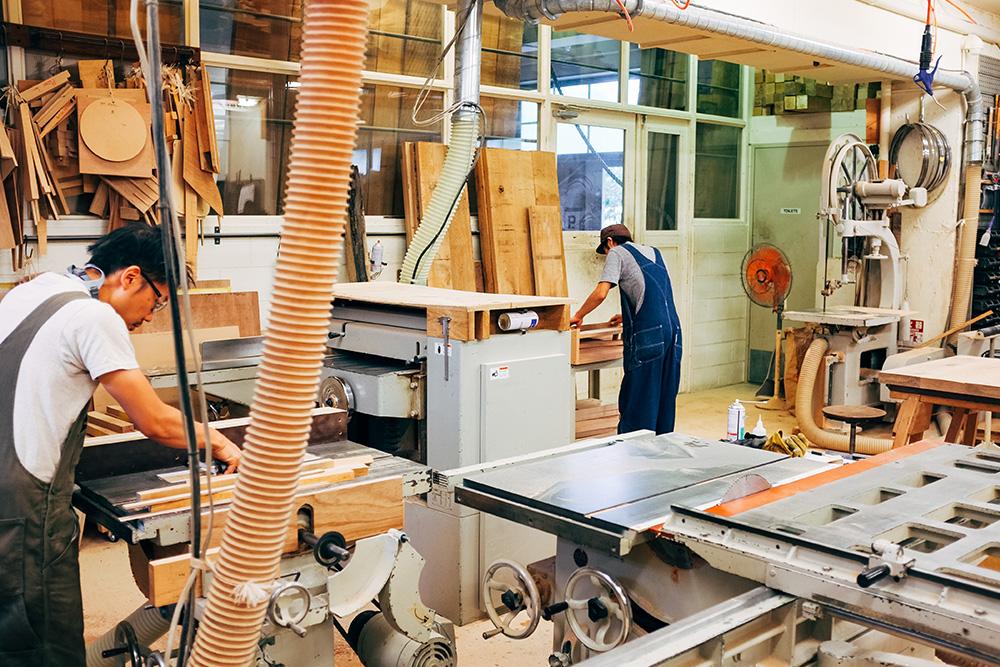 Craftsmen at work inside the workshop of TRUCK Furniture.