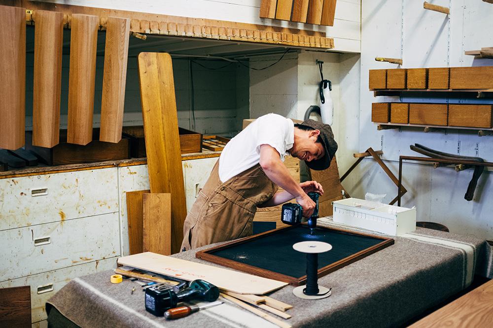 Craftsman inside the workshop building frames.