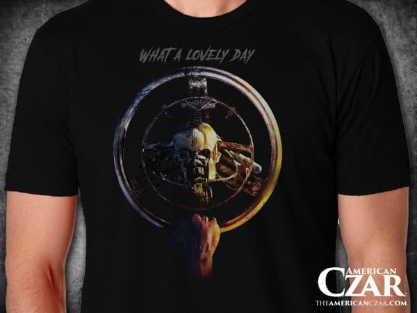 "- American Czar - This fine quality super soft and comfortable shirt features the words ""What a lovely day"" along with a Mad Max Fury Road  War Boys Steering Wheel. Simple and great design."