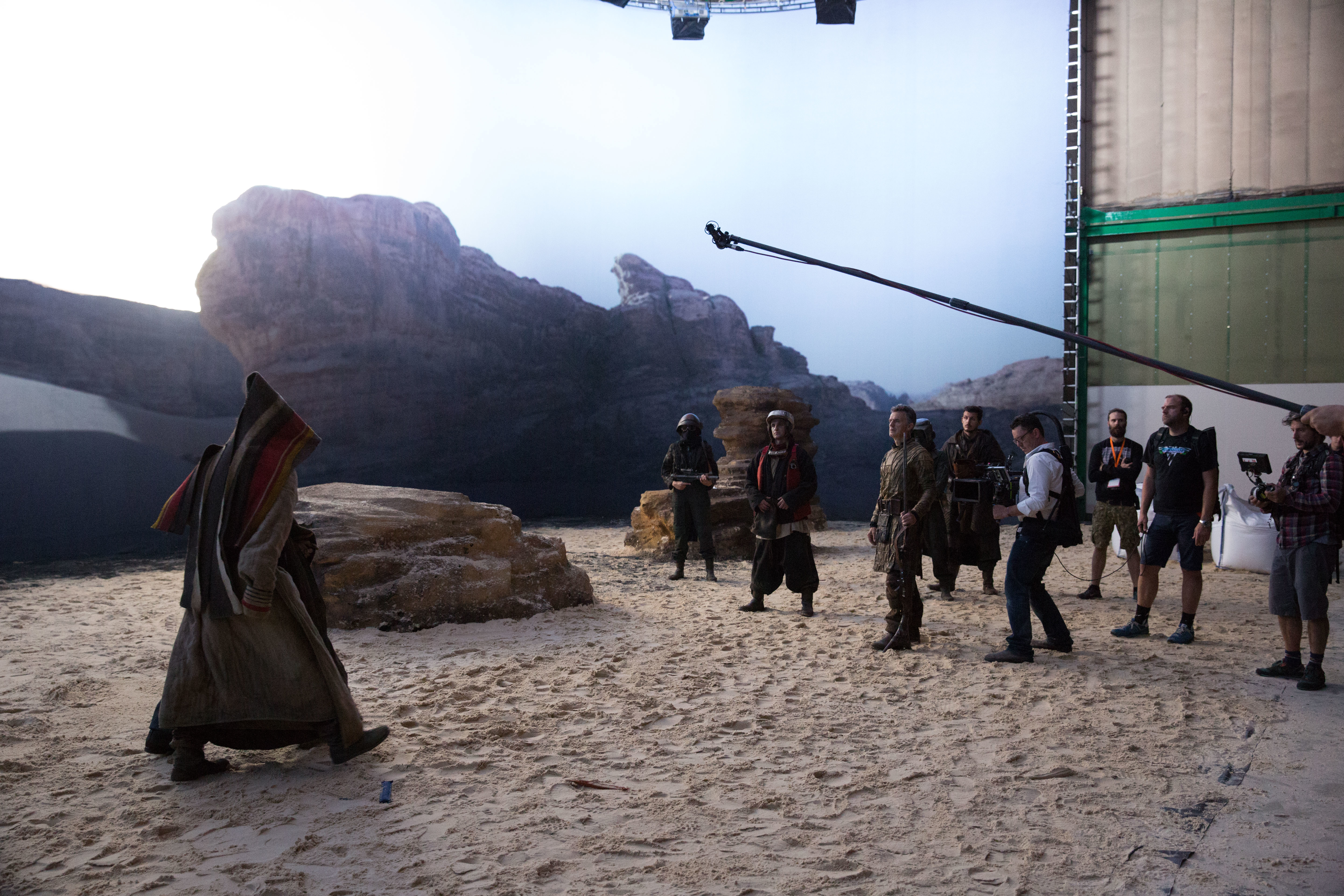 Fraser (operating the camera) and crew capture a Jedha exterior on stage, in front of a backing.