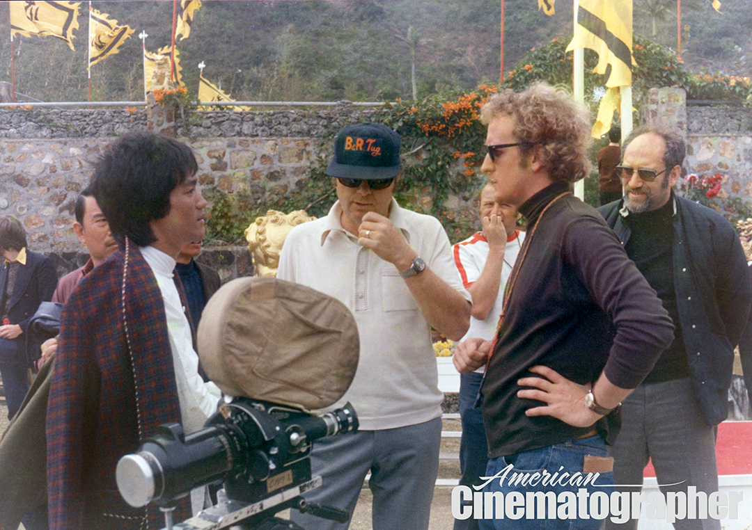 From left, actor and fight choreographer Bruce Lee, director Robert Clouse, cinematographer Gilbert Hubbs, ASC and producer Fred Weintraub on the set of Enter the Dragon.