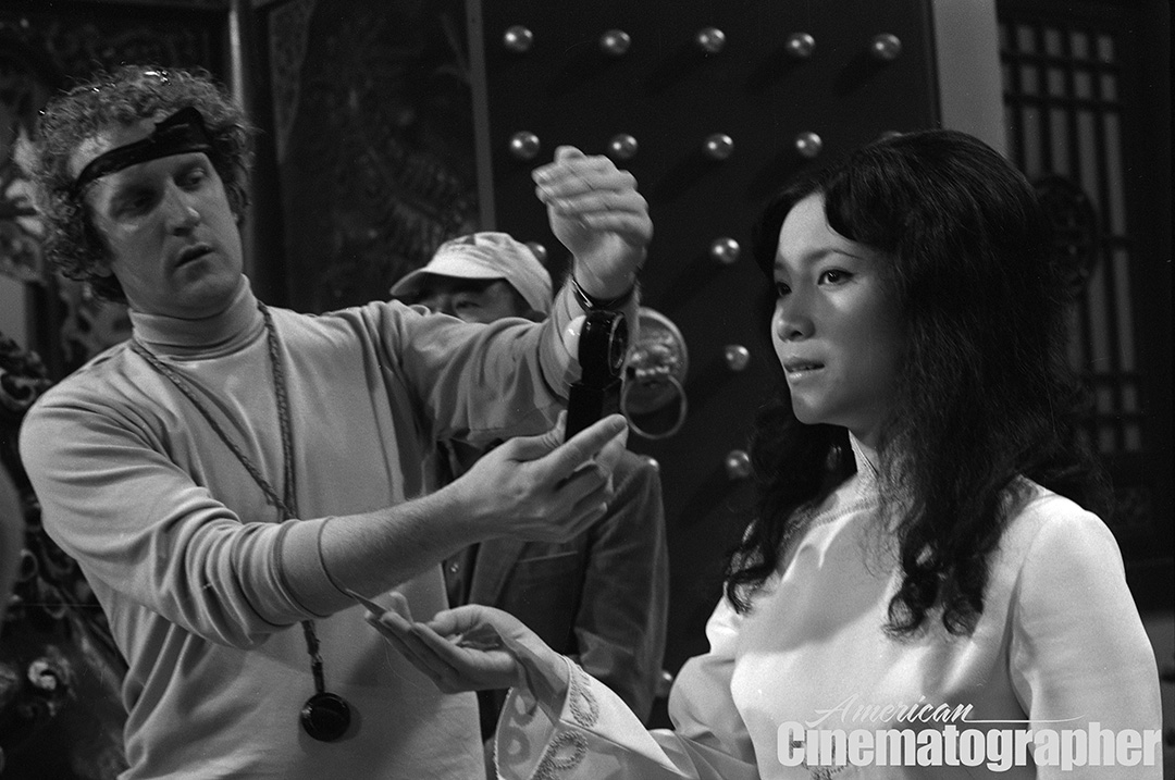 Hubbs sets his light on actress Betty Chung while shooting the banquet scene.
