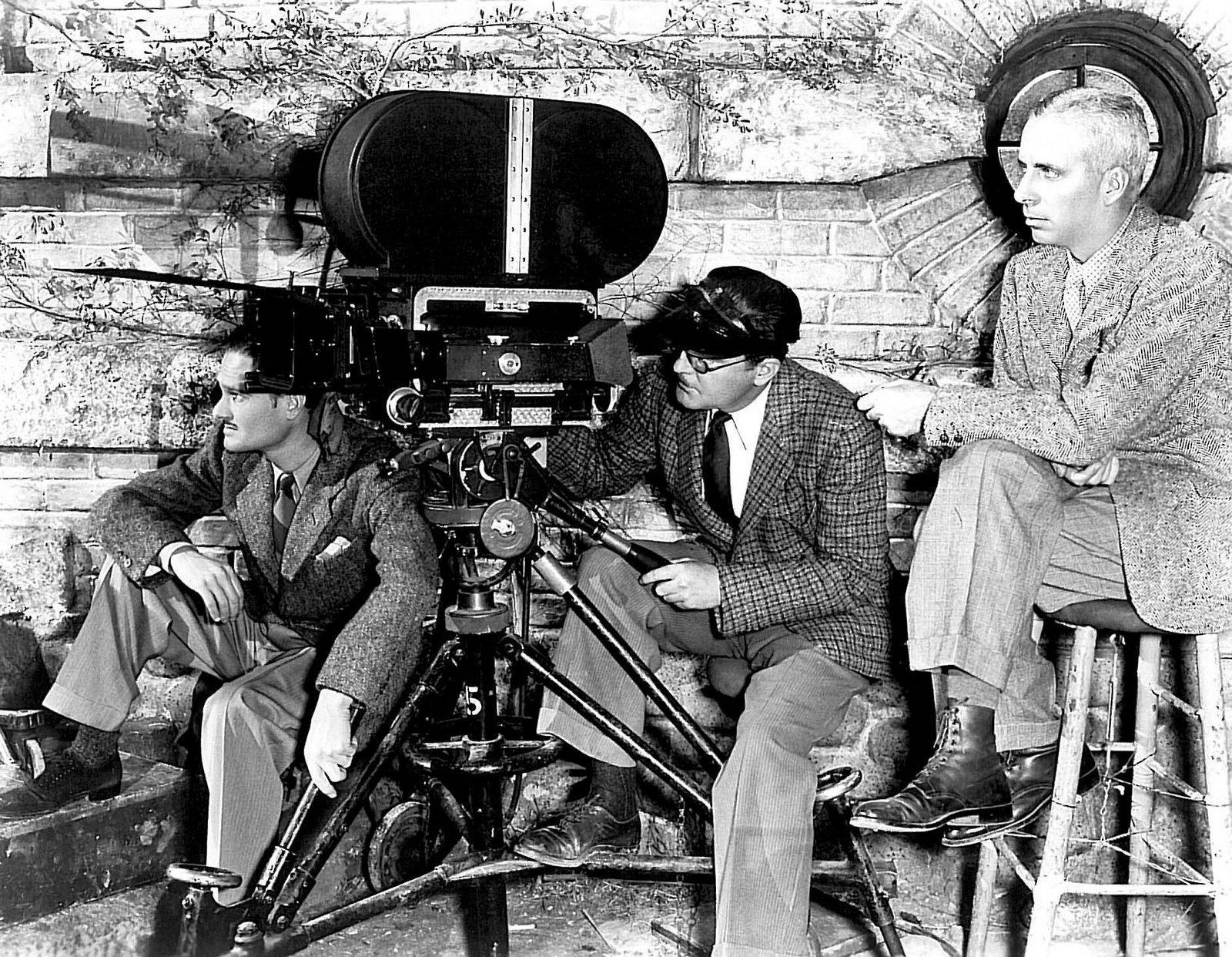 Gregg Toland, ASC (far left) and director Howard Hawks (far right) during the production of the war drama The Road to Glory (1936)