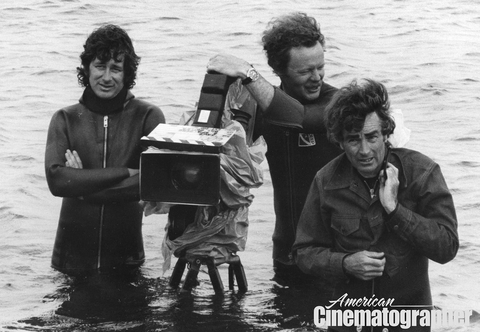 Director Steven Spielberg, operator Michael Chapman and cinematographer Bill Butler, ASC — braving the waves during the lengthy production of Jaws (1975).