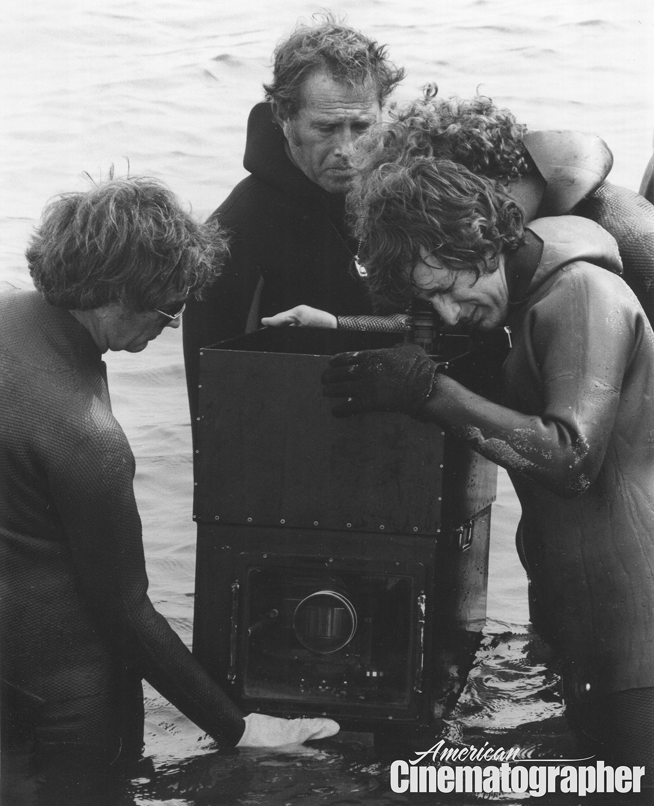 Spielberg checks the frame while shooting at surface level.