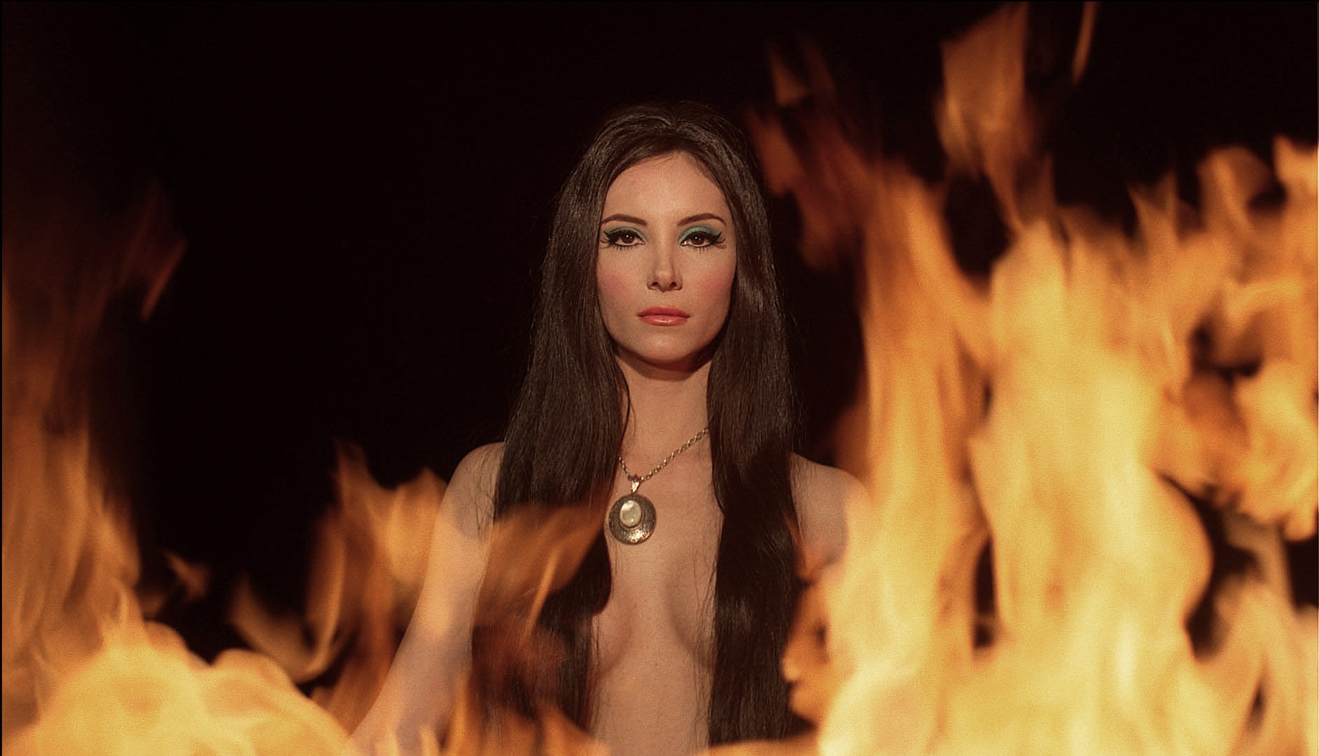 Elaine (actress Samantha Robinson) appears in a seductive fantasy sequence from The Love Witch.