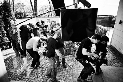 "Jakub ""Kuba"" Kijowski, PSC (second from right, holding camera) on set."