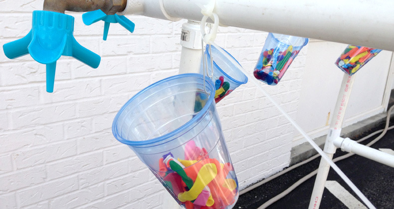 Water balloon filling contraption with spigot, tap and plastic tubing