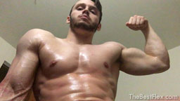 Dominant Stud Oils His Muscles