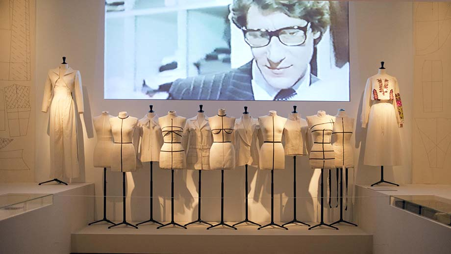 A panoramic view from his work from the 1960s and 1970s  on display at the exhibition 'Yves Saint Laurent, Visionary'.