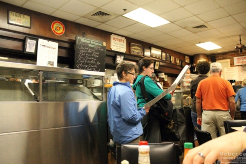 Waiting at the counter to order.