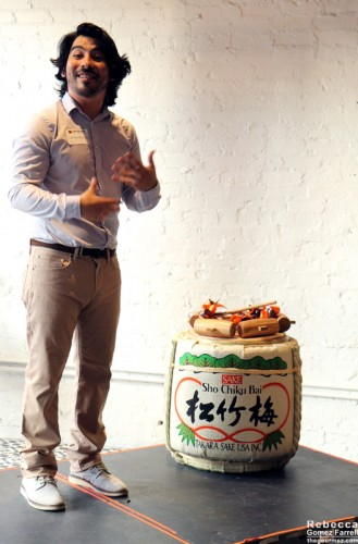 Luis Ruvalbaca, general manager of the Chai Bar, with the celebratory sake barrel.