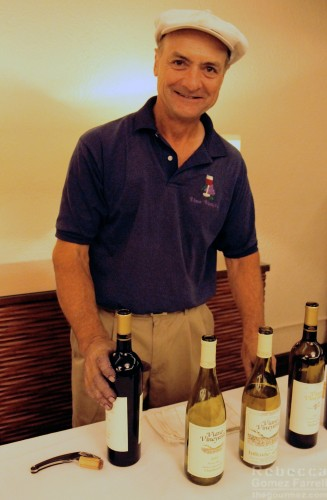 Winemaker John Viano offers a glass.