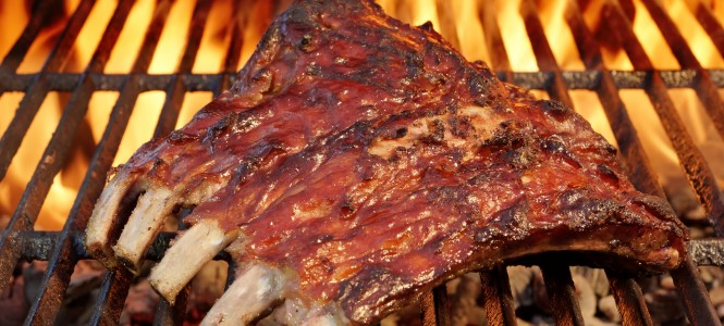Tasty Smoked Pork Spare Ribs On The Hot Flaming  Barbecue Charcoal Grill