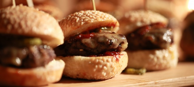 Hamburger sliders  on a rustic cutting wooden board.