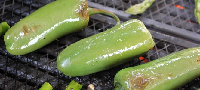 Grilling Jalapenos and asparagus on a barbecue