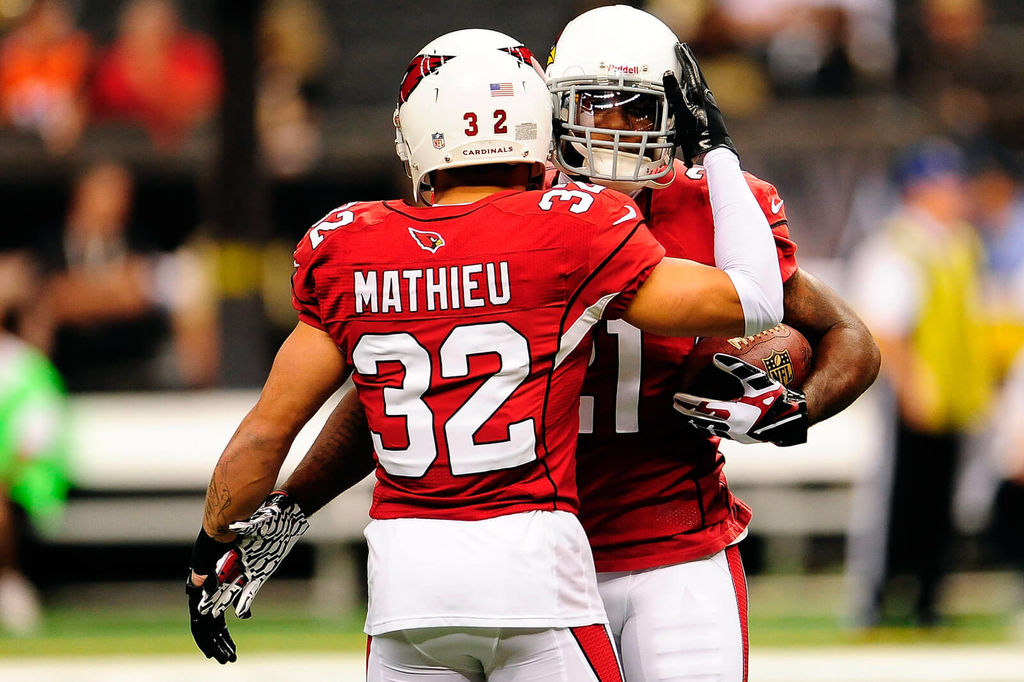 e09ac213012 ... Arizona Cardinals runs out onto the field before Photo Mathieu and  Peterson embrace on the field ...