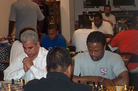 Maurice Playing Blitz Chess In 2001 With The Brothers At The Oxford Chess Club In Brooklyn Photo Credit Daaim Shabazz 465X307