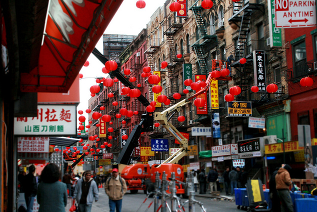 Low-angle shot of red lanterns hanging in Chinatown street
