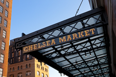 Low-angle shot of Chelsea Market sign on 9th Avenue