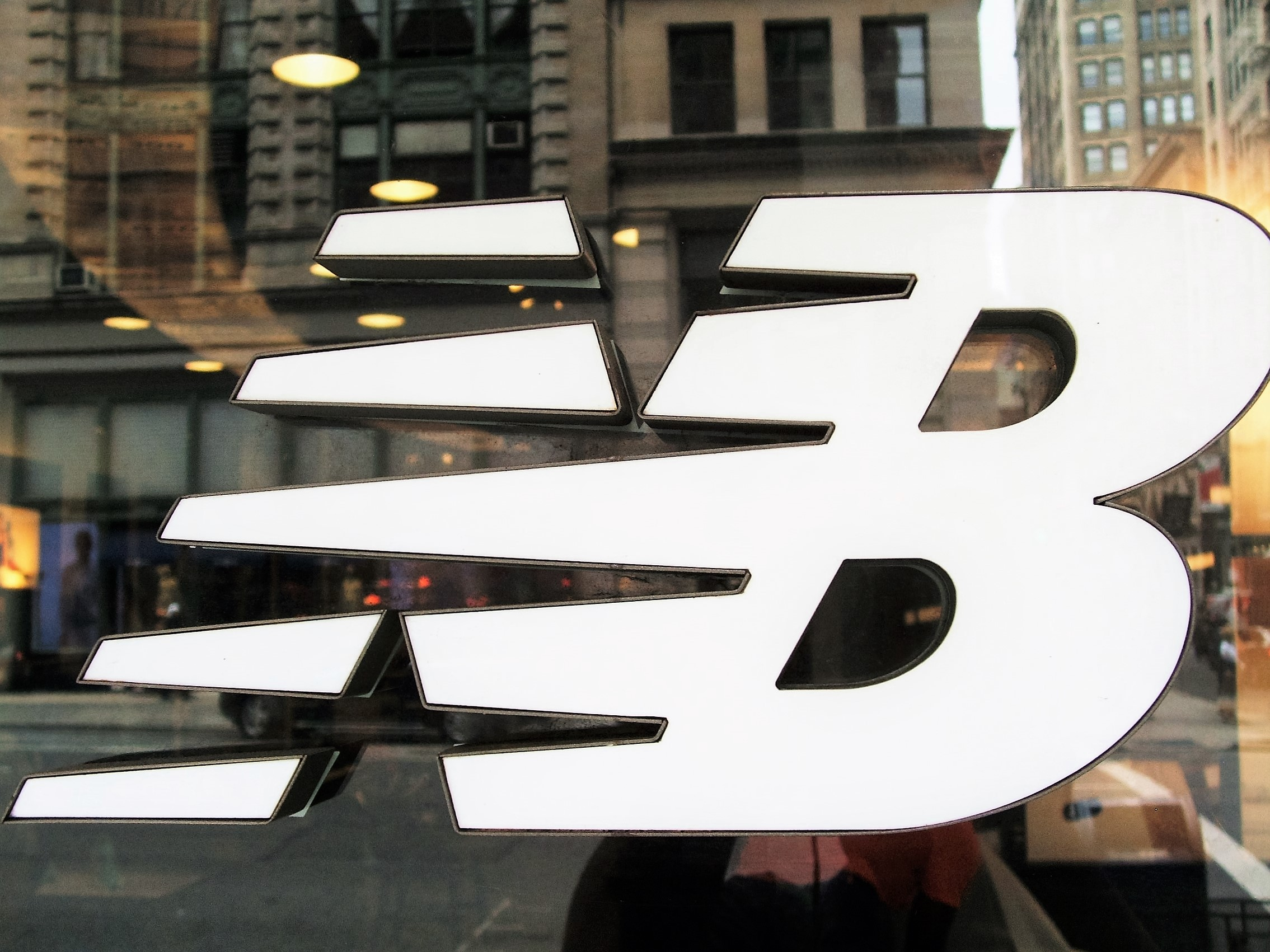 Work-Life Balance: On the opposite corner from the Nike's 5th Ave store, a New Balance store.