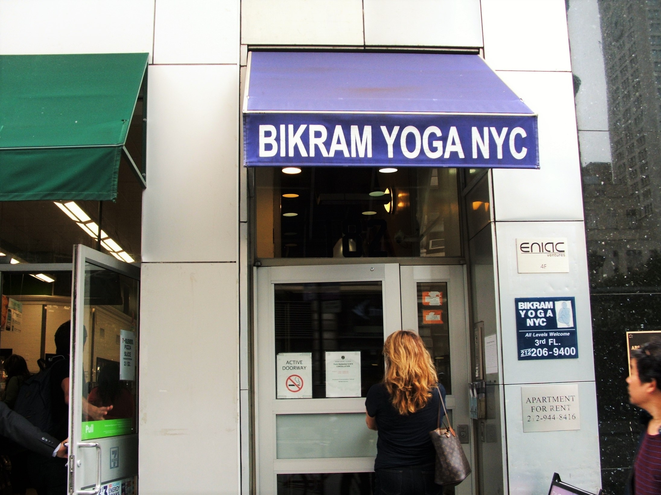 A Bikram Yoga studio...right next to a 7 Eleven on the corner of the W 23rd St's thoroughfare and 5th Ave.