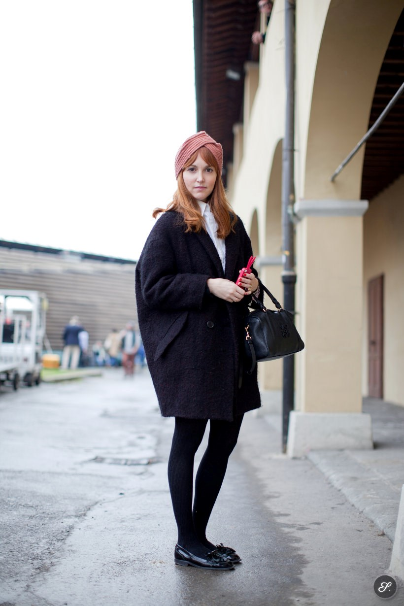 Women on a street fashion photo wearing hat, coat and loafers in Florence.