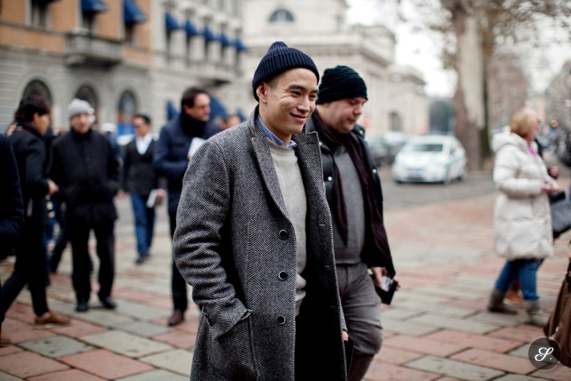 cool men fashion editor wearing a winter coat on a street style photo taken in cold Milan