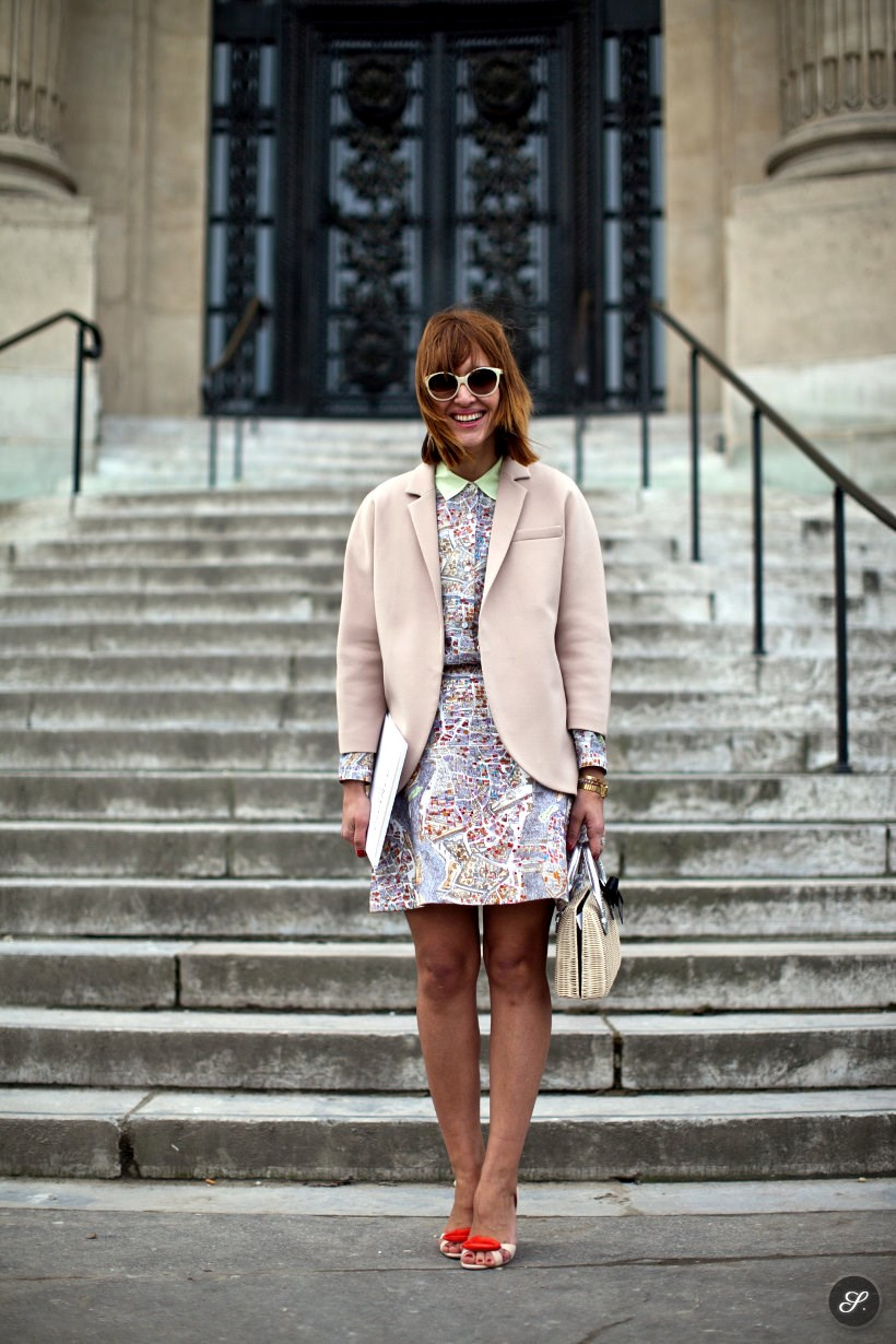 Tiany Kiriloff on a street style photo taken during Paris Fashion Week. She is wearing Carven shirt and skirt, COS jacket and shoes from Louboutin