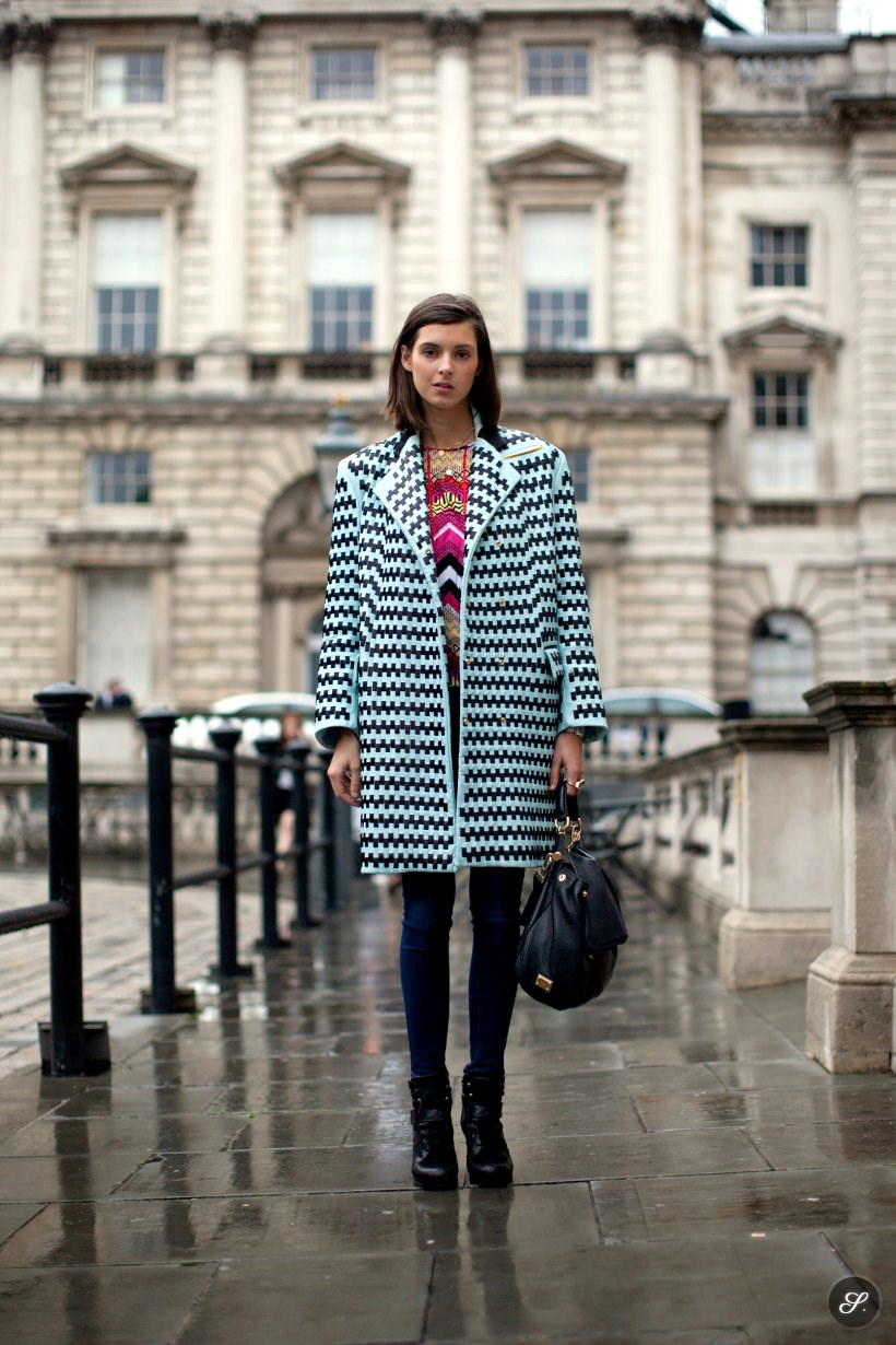 Sophie Warburton wearing Martina Spetlova coat, bag from D&G, jeans form Page, shoes from Adlo and shirt from Carven on a stree style photo taken at Somerset House during London Fashion Week.