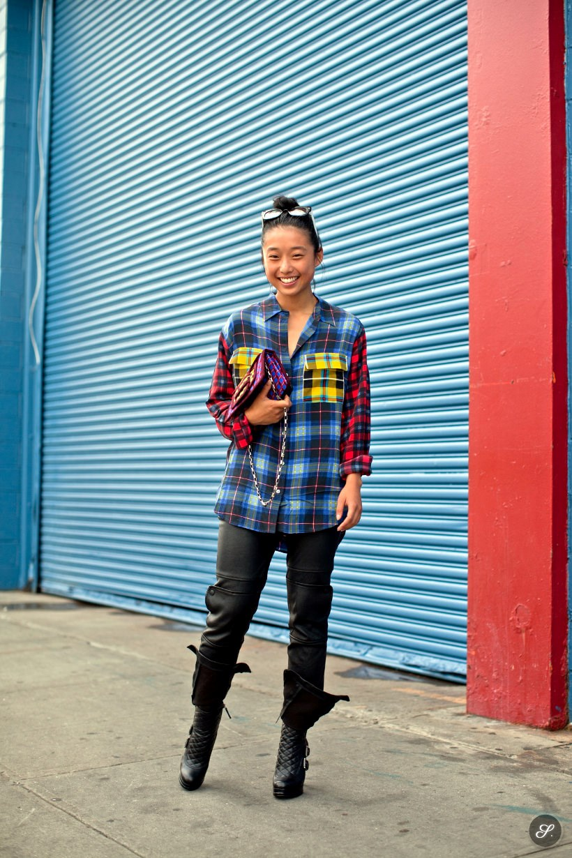 margaret zhang australian fashion blogger of shine by three on a street style photo taken in New York City. Margaret is wearing a colorful shirt, leather pants and black boots.