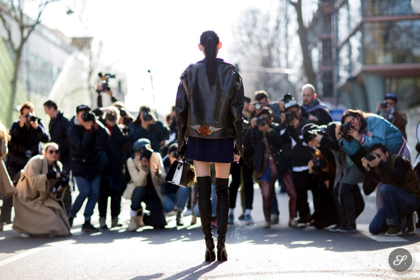 Fashion model Ming Xi infront of street style photographers during Paris Fashion Week PFW.
