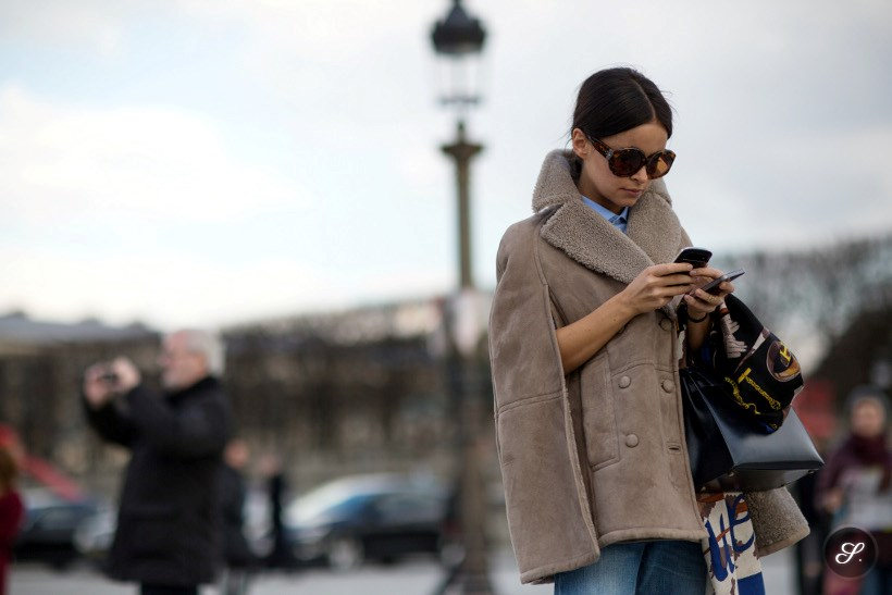 Miroslava Duma on a street style photo taken during Paris Fashion Week Fall/Winter 2014.