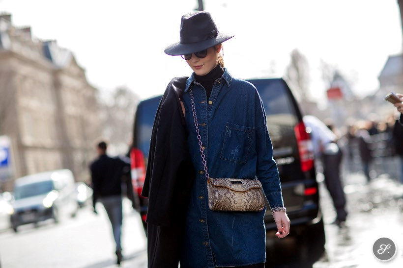 Irene Buffa wearing a denim shirt and hat during Paris Fashion Week Fall/Winter 2014.