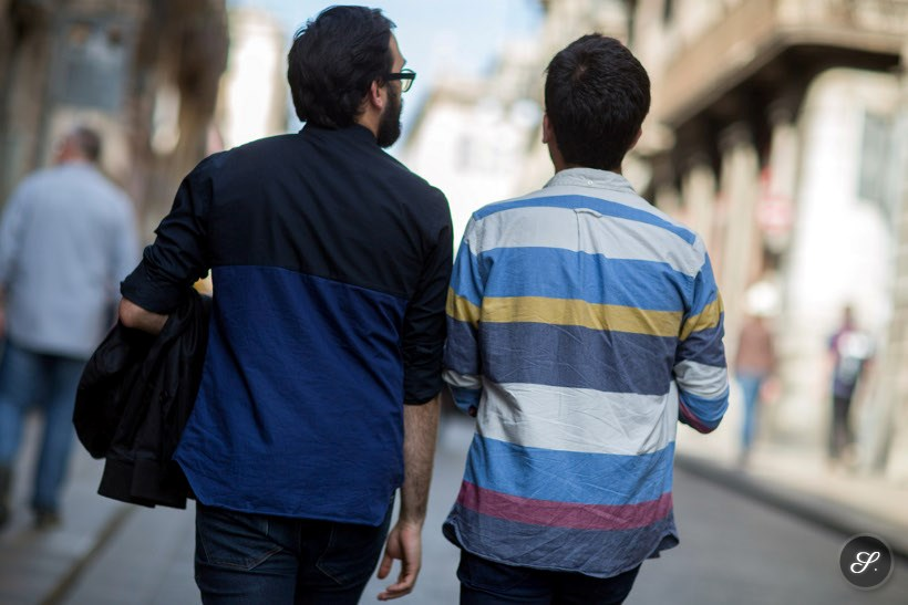 Two men wearing shirts on a spring street style photo taken in Barcelona.