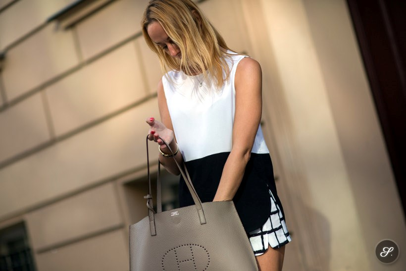 Women wearing a spring outfit on a street style photo taken in Berlin in April 2014. Wearing a Hermes bag and spring shorts.