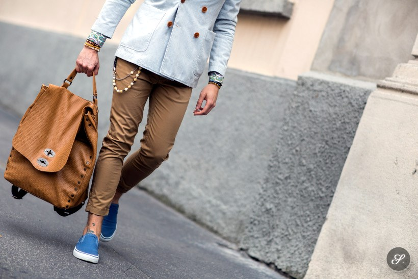 Italian man Marco Taddei wearing blue slippers and a backpack on a street style photot taken during Milan Men Fashion Week 2014.