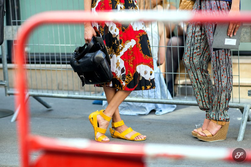 Larissa Thomé wearing a colorful skirt and yellow sandals on a street style photo taken during PFW Paris Fashion Week.